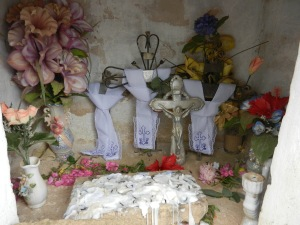 Symbolism of remembering their dead, examples found in a tomb during Dia de Lost Muertos (Day of the Dead)