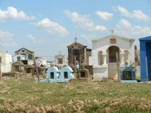 Typical Paraguayan cemetery. They build small cities in honoring their dead. Tombstones range from a simple cross (for the poorest of poor buried in the ground) to small buildings above ground for those with more means.