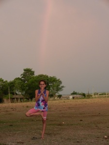 One of my yoga students posing with the rainbow on the soccer (futbol) field.