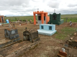 Paraguayan cemetery. Here you can see the full range of graves, from the basic simple cross headstone marking the body in the ground, to the more extravagant tombs built to hold entire families.