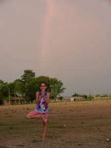"Hilda practicing her best ""Tree"" pose on the soccer field beneath a stellar rainbow."