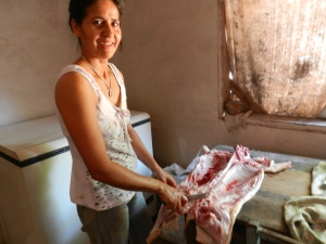 Isabel cutting up a pig for an asado (BBQ) to celebrate my arrival in the community.