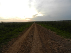 Road toward the lonely end of town. Big Sky country; vast beautiful sky
