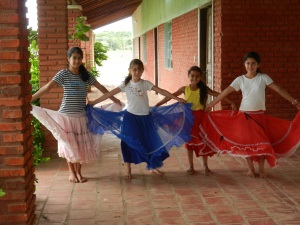 Local girls practicing a traditional Paraguayan dance to celebrate the end of the school year. They love their fancy skirts!