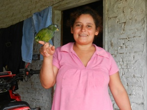 Daughter showing off their pet parrot, known as Loro, which traveled on a motorcycle to join the family for semana santa.