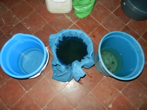 My filtration system from the dirty well. (Right) untreated well water, (Center) filtering through a chamois towel, (Left) boiled and chlorinated.