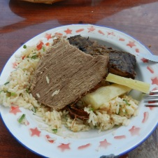 Fiesta Patronal 2014; lunch of BBQd beef, rice salad and mandioca. The cow was killed just the afternoon before.