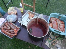 Fiesta Patronal 2014; blood harvested from the cow is made into blood sausage using the intestines and boiled until cooked through.