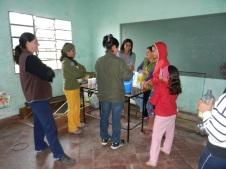 Women's Club making detergent