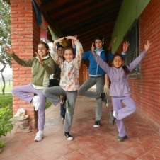 Local kids practicing yoga and 'tree pose'