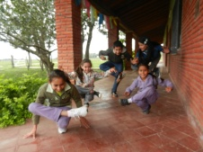 Local kids practicing yoga and 'sitting tree pose'