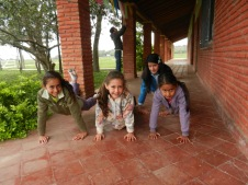 Local kids practicing yoga and 'plank pose'