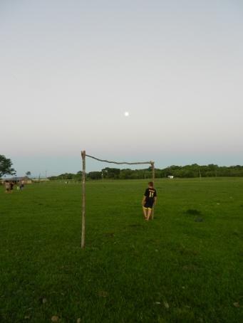 Evening futbol practice. Love the full moon rising behind the goalie