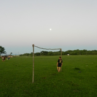 Evening futbol practice. Love the full moon rising behind the goalie